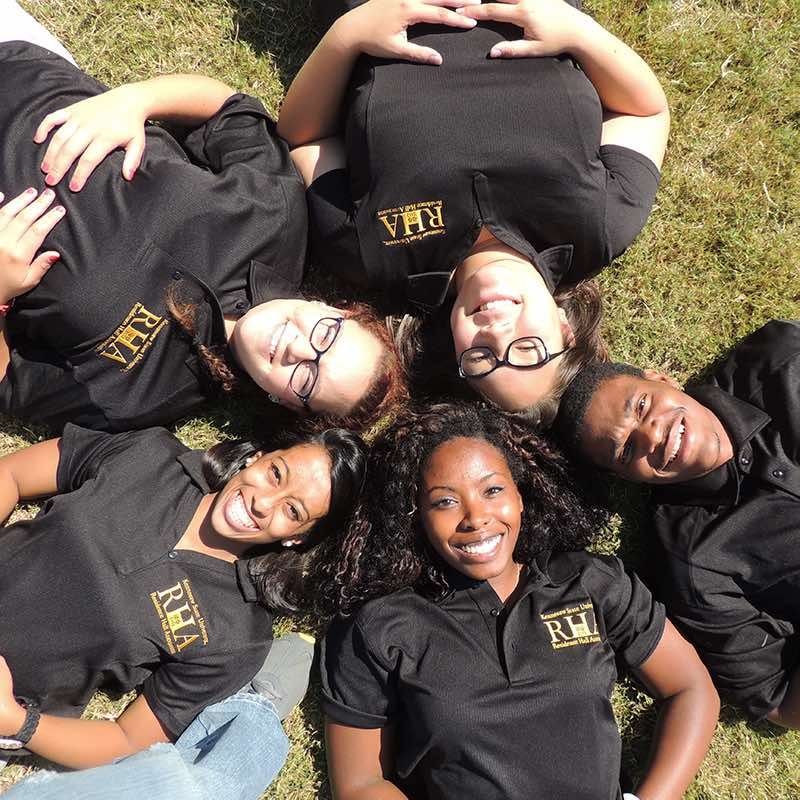 Five RHA members lying on their backs, all of their heads in the middle.